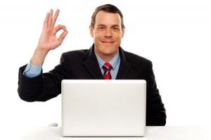 Attractive businessperson showing okay gesture
