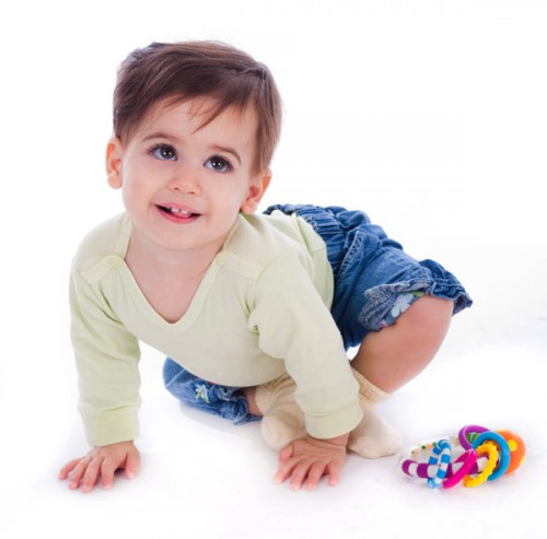 An adorable baby dressed in blue jean and matching top in a isolated background